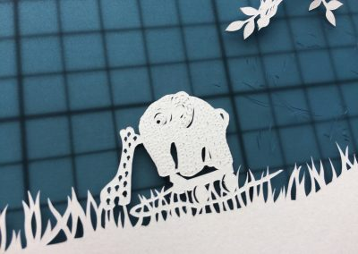 Papercut Birth Announcement - Aksel - detail toys on mat